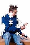 Puzzlespieljunge Stockbilder