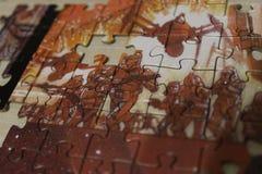 Puzzlespielsoldaten Stockfoto