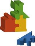 Puzzlespielstücke, die ein Haus bilden Stockfoto
