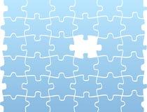 Puzzlespielstücke mit einem leeren Stockfotos