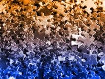Puzzlespielstücke: orange-blau Stockbild