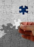 Puzzling. Jigsaw puzzle metaphor for any problem to solve, or process to complete Stock Image