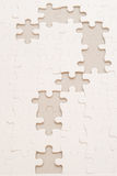 Puzzling Question. Question mark as part of a jigsaw puzzle Royalty Free Stock Photos