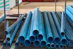 PVC输油管线在地板在仓库里 库存图片