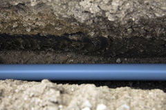 PVC conduit. In the trench royalty free stock photography