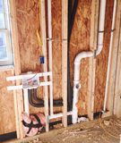 Plumbing Connections for Water Hook-Up. PVC and copper piping and hoses for the installation of a kitchen, bathroom, utility, basin or washer dryer hook-up Stock Images