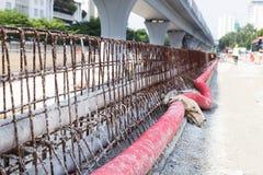 PVC, corrugated plastic pipes, rebar concrete divider in road co Stock Photos