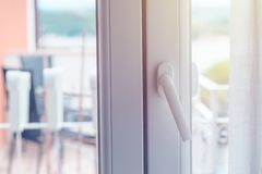 PVC door handle. Seen from the inside of the room Stock Image