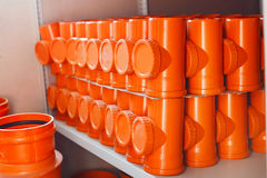 PVC fitting in the warehouse - a draining tee revision pipe Royalty Free Stock Images
