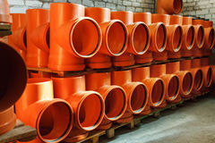 PVC fitting in the warehouse - a draining tee revision pipe Royalty Free Stock Photos