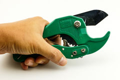 PVC pipe cutter on technician Hand Stock Photos