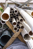 PVC pipe. Irrigation components stacked ready for use in a farm field Stock Images