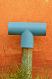 Pvc pipe for sanitary. Sanitary pvc pipe against orange concrete wall Stock Images