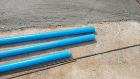 PVC pipe and steel rod on the house floor is mortar cement has t Royalty Free Stock Photo