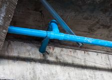 Pvc pipe for water piping system resident. On concrete ceiling background Stock Photo