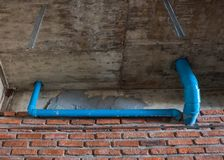Pvc pipe for water piping system resident. On concrete ceiling background Royalty Free Stock Photo