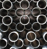 PVC pipes. Stacked on top of each other, cross sectional view stock photography