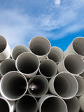 PVC Pipes. Stacked on top of one another with blue sky in the background stock photography