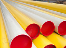 Pvc pipes. Stacked yellow and white pvc pipes royalty free stock image