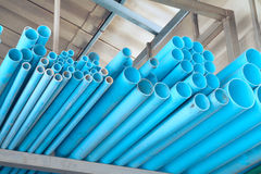 PVC pipes. Pile of blue PVC pipes in warehouse royalty free stock photo