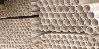 PVC Pipes. Stacks of plastic pvc plumbing pipes at a construction site stock image