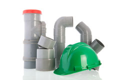 PVC pipes with green helmet Stock Photos
