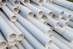 PVC pipes. Heap of PVC pipes stacked at construction site, Close-up royalty free stock photography