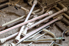 Pvc pipes laying on the dirty floor Stock Photos
