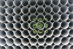 PVC pipes stacked in construction site. Taken on 2014 royalty free stock image