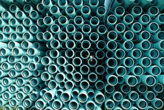 PVC Pipes for water/sewer line. Water/sewer cyan pvc pipes stacks. Looking from the end. Large group royalty free stock photography