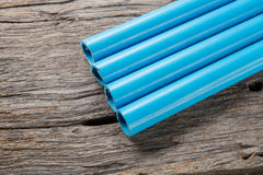 PVC pipes. On wooden table royalty free stock photo