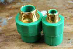 Pvc plumbing fittings and connections. Various pvc plumbing fittings and connections to connect polypropylene tubes used in water distribution systems, bathroom Stock Image
