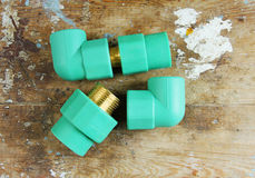 Pvc plumbing fittings and connections. Various pvc plumbing fittings and connections to connect polypropylene tubes used in water distribution systems, bathroom Stock Images