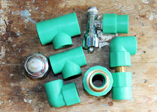 Pvc plumbing fittings and connections. Various pvc plumbing fittings and connections to connect polypropylene tubes used in water distribution systems, bathroom Royalty Free Stock Photo