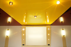 Pvc stretch ceiling film. Pvc stretch ceiling film with halogen lamps royalty free stock photos