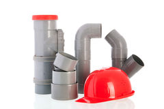 PVC tubes and pipes. With red safety helmet Stock Images