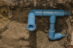 PVC Water Pipe in the smashed wall Stock Image