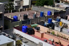 PVC water storage tanks installed on row house terraces