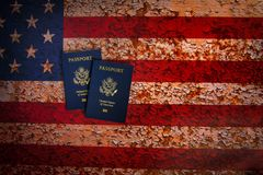 Pverhead view of two US passports on a rustic american flag background royalty free stock images
