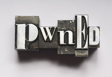 Pwned. The word Pwned photographed using vintage type characters. See my other member portfolio for more vintage type images Royalty Free Stock Photography