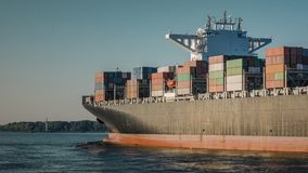 Container ship on the River Elbe at sunset stock photography