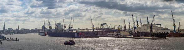 Large Panorama of the Hamburg Harbour in sunny weather with few clouds.  royalty free stock photos