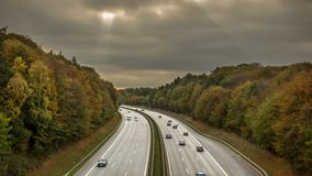 Motorway through a wooded area.  royalty free stock photos