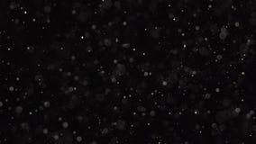 Pył cząsteczki są migocące na czarnym tle swobodny ruch royalty ilustracja