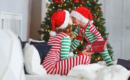 Py family mother hug her baby son in pajamas opening gifts on c royalty free stock photo