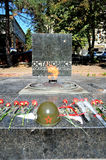 Pyatigorsk- Russia's jewel. The  Eternal   Flame  is permanently glowing  in memory of the fallen heroes at the memorial site. The WW II soldier's helmet with Royalty Free Stock Photography