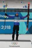 Olympic champion Martin Fourcade of France celebrates victory in biathlon men`s 15km mass start at the 2018 Winter Olympics. PYEONGCHANG, SOUTH KOREA – Royalty Free Stock Image