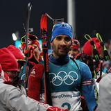 Olympic champion Martin Fourcade of France celebrates victory in biathlon men`s 15km mass start at the 2018 Winter Olympics Royalty Free Stock Photography