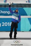 Olympic champion Martin Fourcade of France celebrates victory in biathlon men`s 15km mass start at the 2018 Winter Olympics Royalty Free Stock Photo
