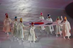The 2018 Winter Olympics Opening Ceremony. PYEONGCHANG, SOUTH KOREA - FEBRUARY 9, 2018: Former South Korean Olympians and Olympic gold medalists carry the Royalty Free Stock Photos